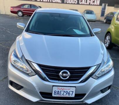 2016 Nissan Altima for sale at Global Auto Group in Fontana CA