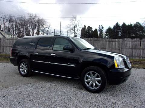 2014 GMC Yukon XL for sale at JEFF MILLENNIUM USED CARS in Canton OH