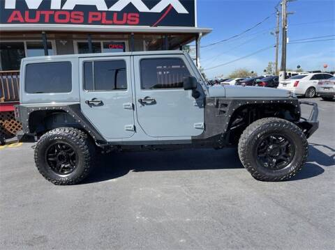 2015 Jeep Wrangler Unlimited for sale at Ralph Sells Cars at Maxx Autos Plus Tacoma in Tacoma WA