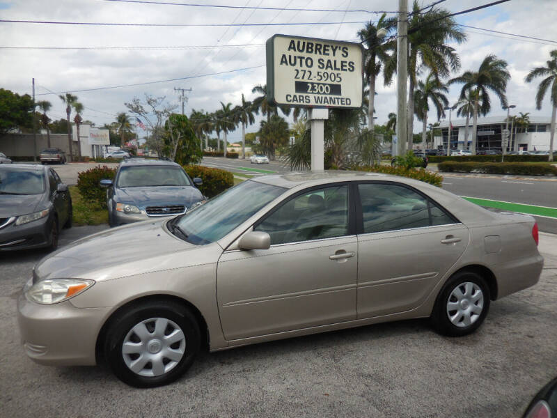 2004 Toyota Camry for sale at Aubrey's Auto Sales in Delray Beach FL