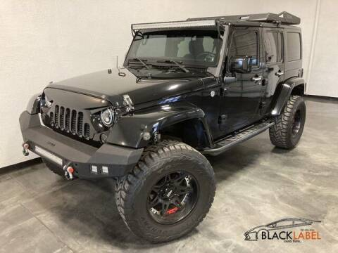 2012 Jeep Wrangler Unlimited for sale at BLACK LABEL AUTO FIRM in Riverside CA