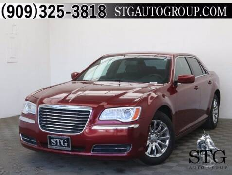 2014 Chrysler 300 for sale at STG Auto Group in Montclair CA