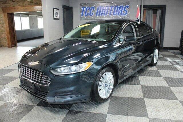 2014 Ford Fusion Hybrid for sale at TCC Motors in Farmington Hills MI