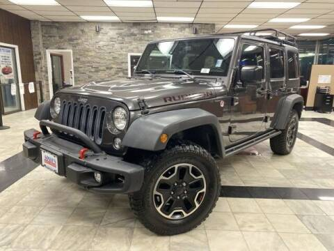 2016 Jeep Wrangler Unlimited for sale at Sonias Auto Sales in Worcester MA