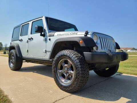 2012 Jeep Wrangler for sale at Classic Car Deals in Cadillac MI