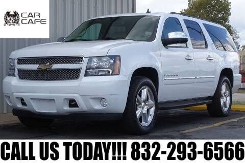 2009 Chevrolet Suburban for sale at CAR CAFE LLC in Houston TX