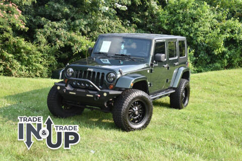 2010 Jeep Wrangler Unlimited for sale at Alpha Motors in Knoxville TN