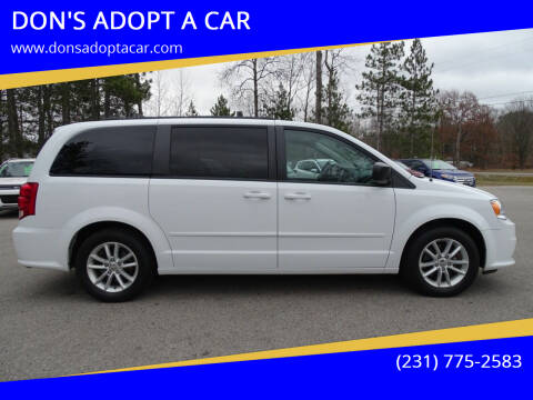 2014 Dodge Grand Caravan for sale at DON'S ADOPT A CAR in Cadillac MI