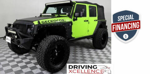2013 Jeep Wrangler Unlimited for sale at Driving Xcellence in Jeffersonville IN