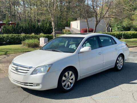 2006 Toyota Avalon for sale at Triangle Motors Inc in Raleigh NC