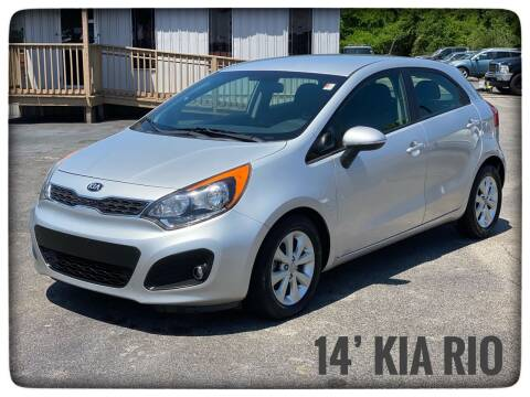 2014 Kia Rio 5-Door for sale at ASTRO MOTORS in Houston TX