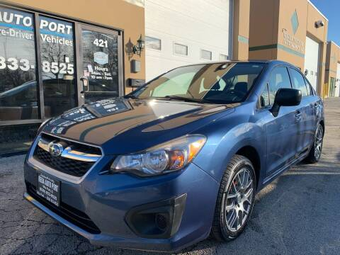 2012 Subaru Impreza for sale at REDA AUTO PORT INC in Villa Park IL