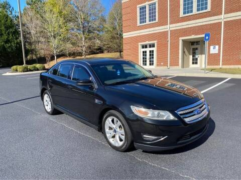 2012 Ford Taurus for sale at Two Brothers Auto Sales in Loganville GA