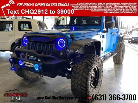 2016 Jeep Wrangler Unlimited for sale at CERTIFIED HEADQUARTERS in St James NY
