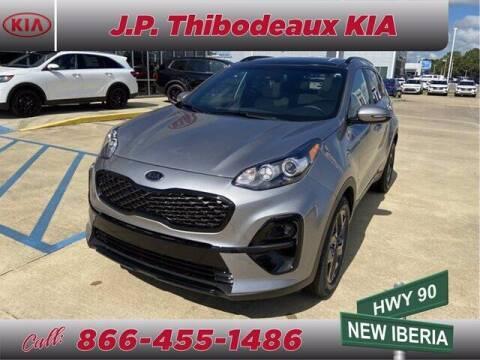 2021 Kia Sportage for sale at J P Thibodeaux Used Cars in New Iberia LA
