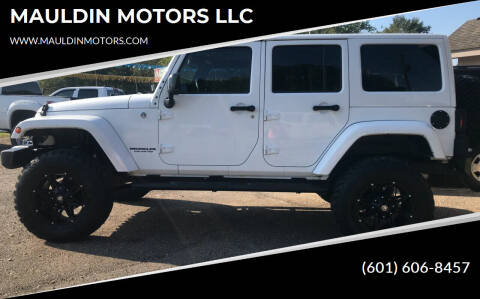 2014 Jeep Wrangler Unlimited for sale at MAULDIN MOTORS LLC in Sumrall MS