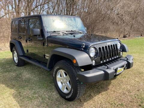 2014 Jeep Wrangler Unlimited for sale at M & M Motors in West Allis WI