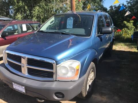 2006 Dodge Durango for sale at BARNES AUTO SALES in Mandan ND
