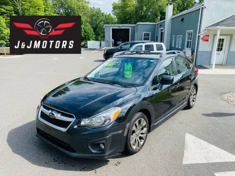 2012 Subaru Impreza for sale at J & J MOTORS in New Milford CT