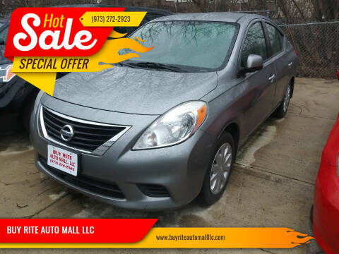 2013 Nissan Versa for sale at BUY RITE AUTO MALL LLC in Garfield NJ