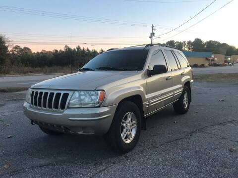 2000 Jeep Grand Cherokee for sale at CAR STOP INC in Duluth GA
