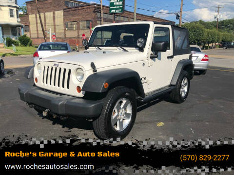 2009 Jeep Wrangler for sale at Roche's Garage & Auto Sales in Wilkes-Barre PA