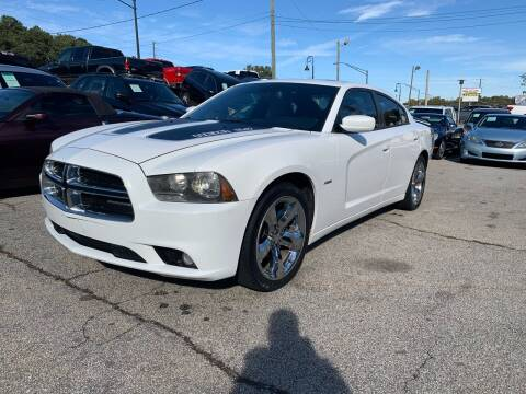 2011 Dodge Charger for sale at Philip Motors Inc in Snellville GA
