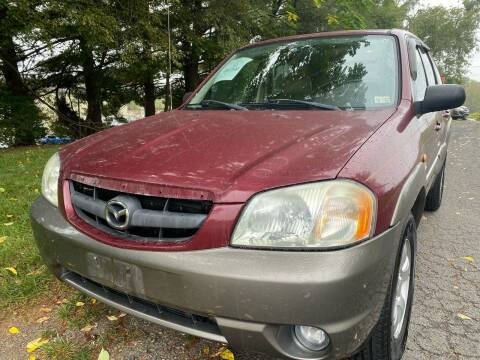 2004 Mazda Tribute for sale at Dreams Auto Sales LLC in Leesburg VA