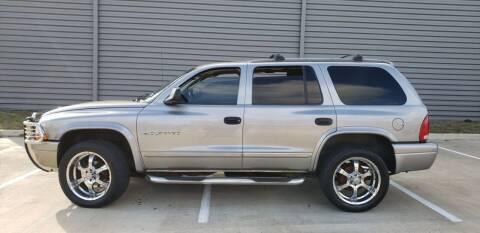 2001 Dodge Durango for sale at AC MOTORCARS LLC in Houston TX