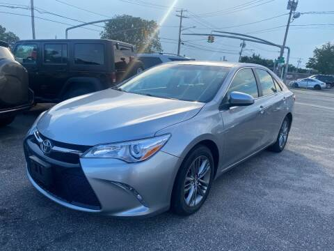2015 Toyota Camry for sale at American Best Auto Sales in Uniondale NY