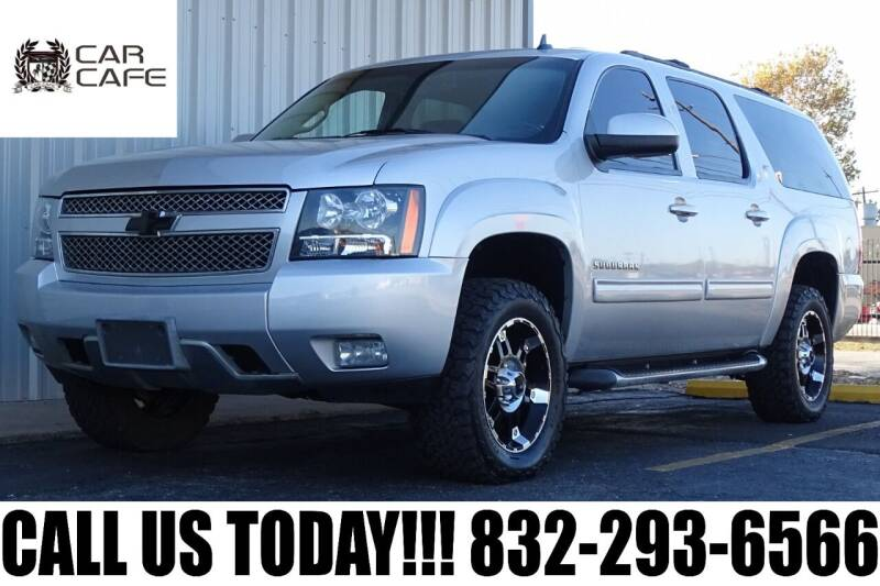 2013 Chevrolet Suburban for sale at CAR CAFE LLC in Houston TX