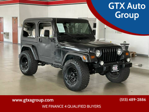 2002 Jeep Wrangler for sale at GTX Auto Group in West Chester OH