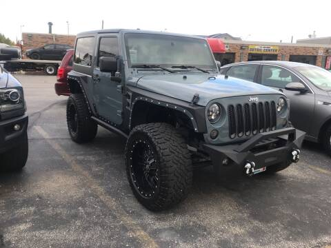 2015 Jeep Wrangler for sale at Carney Auto Sales in Austin MN