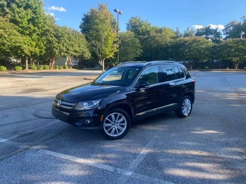 2013 Volkswagen Tiguan for sale at Uniworld Auto Sales LLC. in Greensboro NC