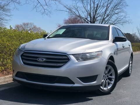 2014 Ford Taurus for sale at William D Auto Sales in Norcross GA