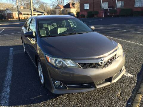 2014 Toyota Camry for sale at DEALS ON WHEELS in Moulton AL