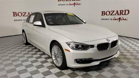 2013 BMW 3 Series for sale at BOZARD FORD in Saint Augustine FL