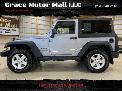 2016 Jeep Wrangler for sale at Grace Motor Mall LLC in Traverse City MI