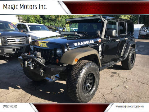 2012 Jeep Wrangler Unlimited for sale at Magic Motors Inc. in Snellville GA