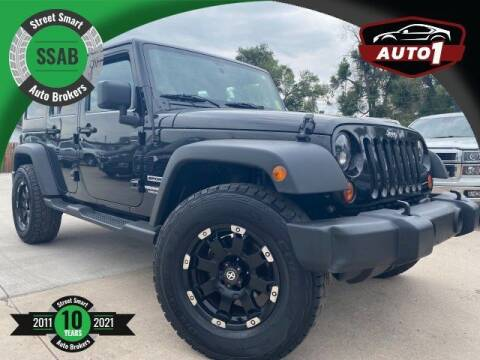 2012 Jeep Wrangler Unlimited for sale at Street Smart Auto Brokers in Colorado Springs CO