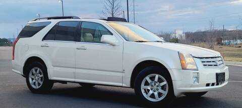 2006 Cadillac SRX for sale at BOOST MOTORS LLC in Sterling VA