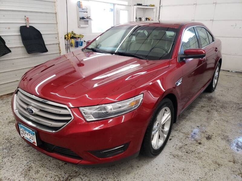 2014 Ford Taurus for sale at Jem Auto Sales in Anoka MN