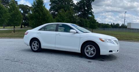 2009 Toyota Camry for sale at GTO United Auto Sales LLC in Lawrenceville GA