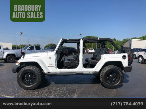 2016 Jeep Wrangler Unlimited for sale at BRADBURY AUTO SALES in Gibson City IL