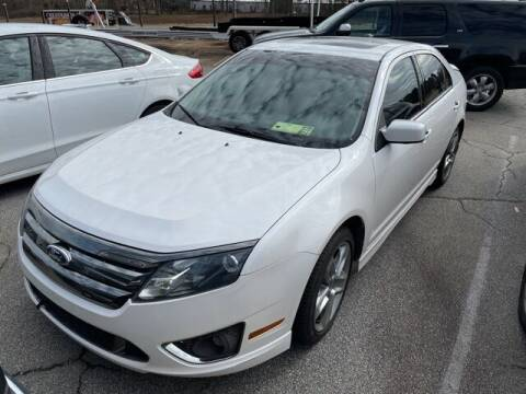 2012 Ford Fusion for sale at BILLY HOWELL FORD LINCOLN in Cumming GA