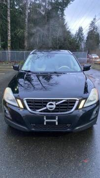 2010 Volvo XC60 for sale at Road Star Auto Sales in Puyallup WA
