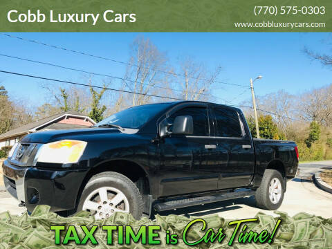 2009 Nissan Titan for sale at Cobb Luxury Cars in Marietta GA