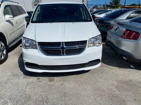 2014 Dodge Grand Caravan for sale at America Auto Wholesale Inc in Miami FL
