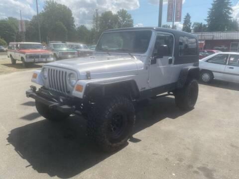 2004 Jeep Wrangler for sale at MILLENNIUM MOTORS INC in Monroe WA