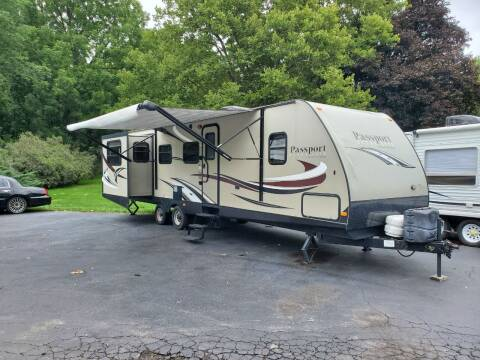 2015 KEYSTONE PASSPORT ULTRA LITE 3180 RE for sale at Mancuso Country Auto in Batavia NY